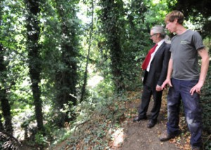 Rob Brooks, rear, inspects the Brickmakers' Wood site along with Eden-Rose Coppice Trust employee Sam Chamberlin.